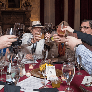 Houston Murder Mystery guests raise glasses