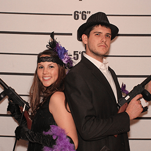 Houston Murder Mystery party guests pose for mugshots